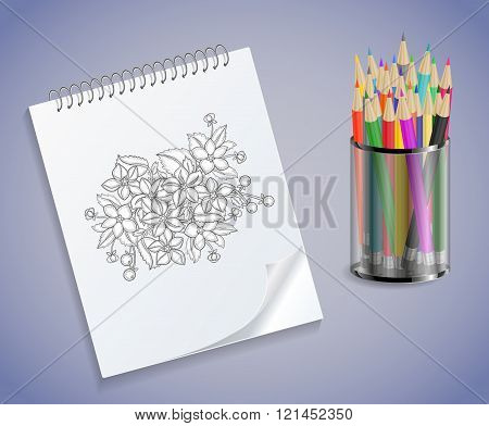 Notebook With Flowers And Colored Pencils