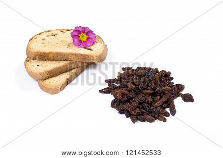 Three Croutons Decorated With A Flower And Raisin Handful