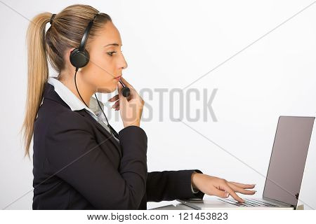 call center female worker specializing in calls that are outbound (for sales, promotion or other messages)