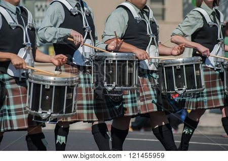Line of kilted drummers
