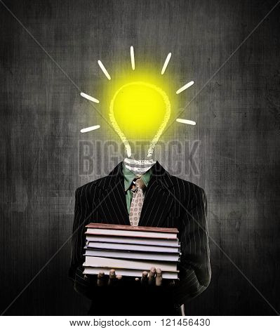 Ideas Bulb Igniting And Holding Books And Wearing Suit While Standing Before A Chalkboard