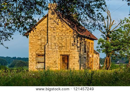 An Old Abandoned Texas Homestead Farmhouse in a Beautiful Field Full of Various Texas Wildflowers.