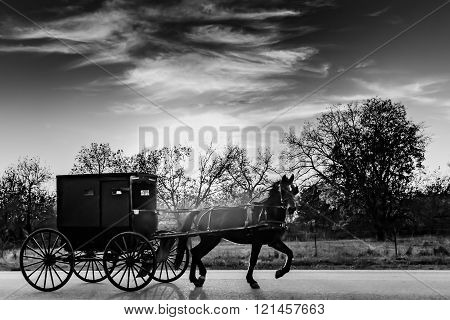Black and White Rendering of a Horse and Buggy on a Rural Highway in Oklahoma Amish Country at Sunset
