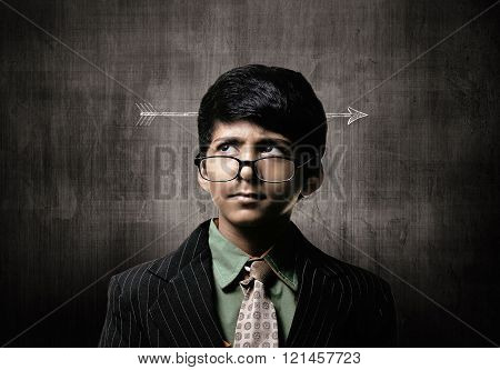 Genius Little Boy Wearing Glasses, Thinking Near Chalkboard