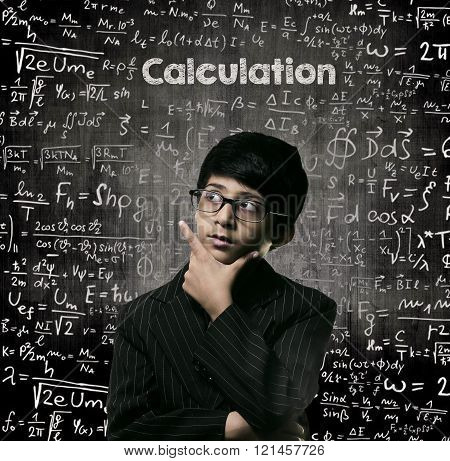Calculation. Genius Little Boy Thinking Wearing Glasses Chalkboard