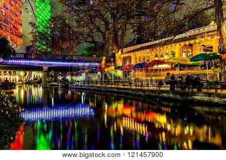 Night Time Scenic Views of the Riverwalk with Christmas Lights on a Rainy Day at San Antonio Texas.