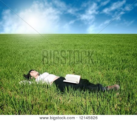 a woman on the grass field