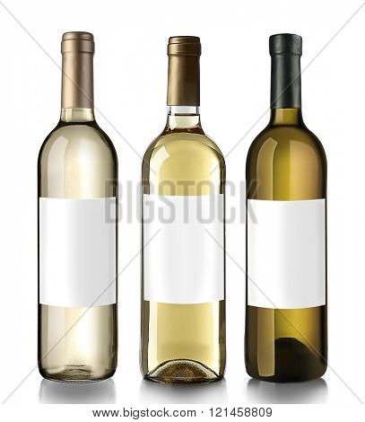 Bottles of white wine with empty labels, isolated on white