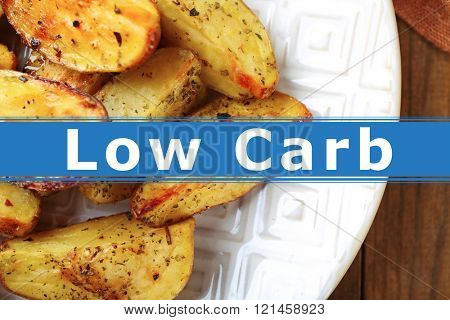 Homemade fried potato on plate and text Low Carb on wooden table background
