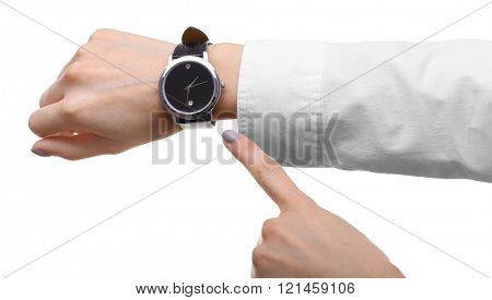 Modern watch on a woman's wrist isolated on white