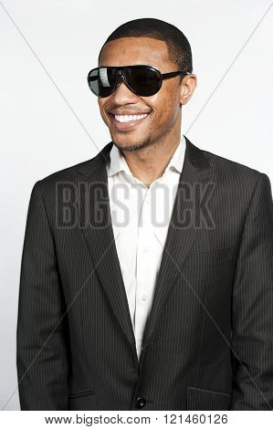 Portrait Of A Happy Black Male In Suit and Sunglasses
