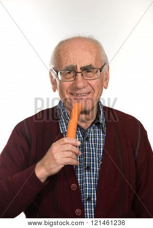 old man eating carrot
