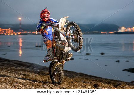 Yuzhno-Sakhalinsk , Russia - August 13, 2015: motorcycle Enduro riding wheelies on the beach