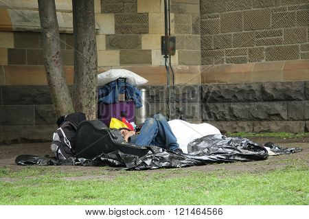 Homeless man near St. Paul's Cathedral in Downtown Melbourne