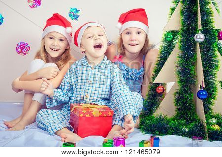 Happy Little Smiling Boy And Girls With Christmas Hat.