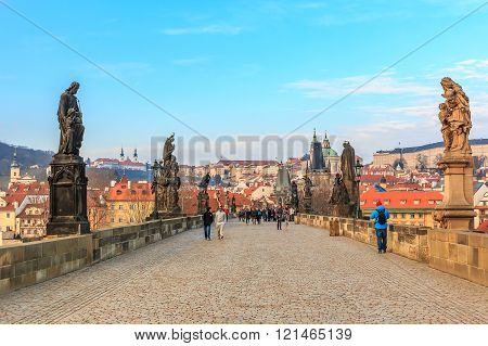 Prague, Czech Republic - January 16 2015: Pedestrians only Charles Bridge (a.k.a. Stone Bridge Kamenny most Prague Bridge Prazhski most) over Vltava river in Prague Czech Republic