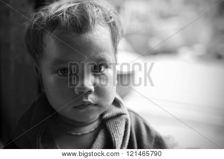 MINDAT, MYANMAR - DECEMBER 7, 2015: Photo of a Chin tribe child. Chin people, also known as the Kukis are a number of Tibeto-Burman tribal people. Black & White photo.