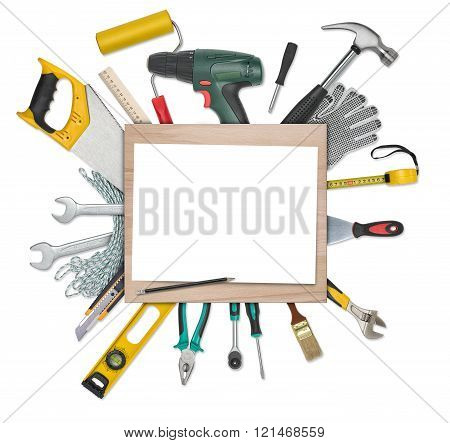 Set of instruments and tools underneath wooden desk with white blank paper. Copy space at center