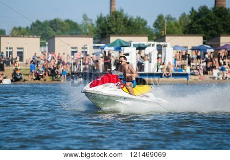 Man On Jet Ski Turns With Much Splashes