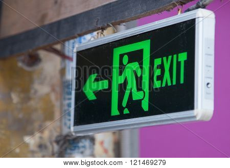 Exit sign points the way out in case of emergency