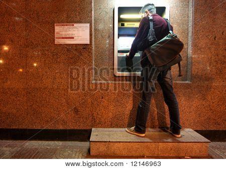 Man take money in cash dispense for credit card