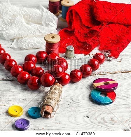 Beads,thread And Red Cloth