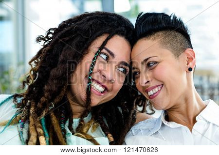 Close-up of lesbian couple looking at each other and smiling