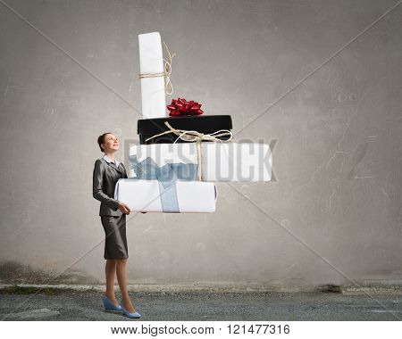 Businesswoman receiving or presenting gifts