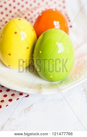 Three doted eggs in the plate as a decoration for easter dinner