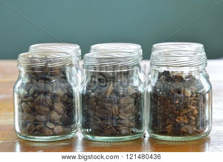 sunflower seed in the glass bottle on table