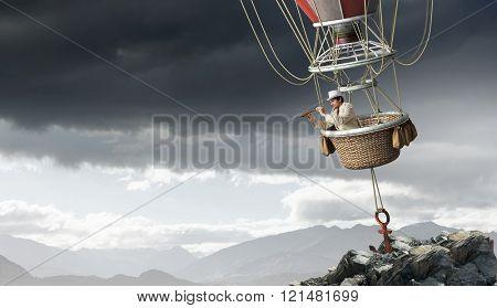 Man travel in aerostat