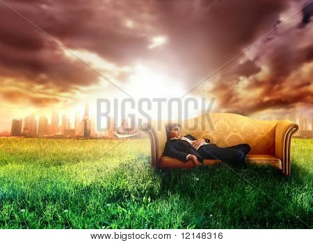 a business man on the sofa in countryside
