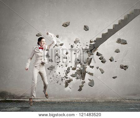 Woman breaking ladder