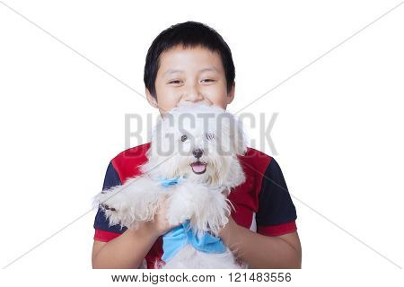Cute Asian Boy Holds Maltese Dog