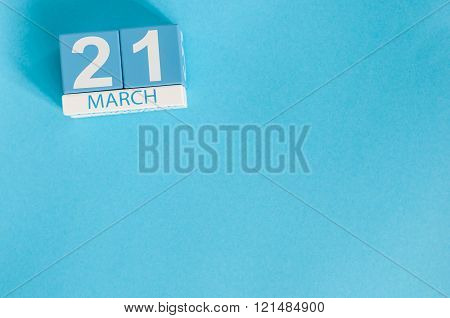 March 21st. Image of march 21 wooden color calendar on blue background.  Spring day, empty space for