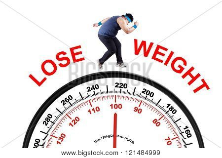 Overweight Man With Scale