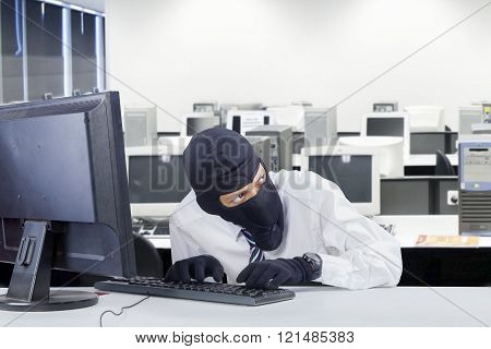 Watchful Robber Hacking Computer In Office