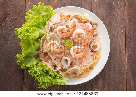 Vermicelli salad on woooden table.