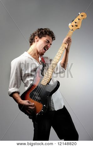 young man playing bass guitar