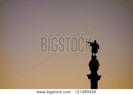 Barcelona Christopher Columbus statue silhouette  over sunset clear sky