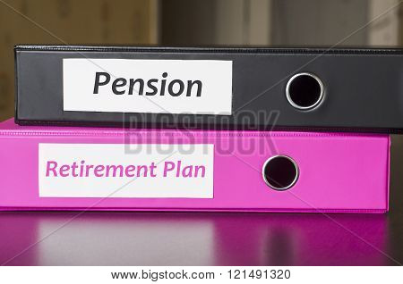 Bright office folders over dark background and retirement plan and pension text concept