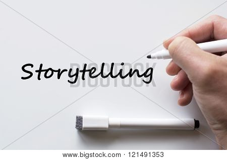 Human hand writing storytelling on whiteboard background
