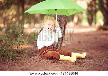 Funny kid girl with umbrella
