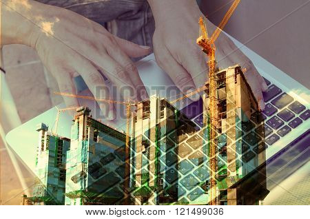Double Exposure Of Business Man Use Notebook With Construction Site