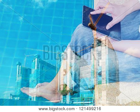 Double Exposure Of Business Man Use Tablet With Construction Site