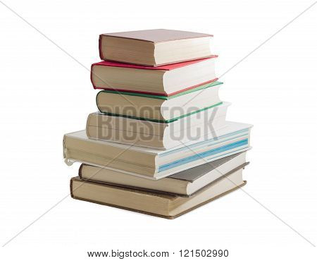 Stack Of Several Different Books On A Light Background