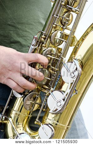 Men Playing Saxophone Closeup