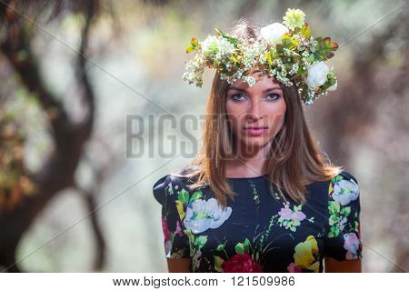 Young pretty woman in a olive forest