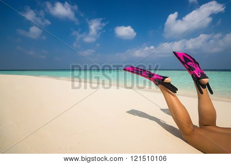 Woman Relaxing On Summer Beach Vacation Holidays Lying In Sand. Flippers In Legs. Diver Fins