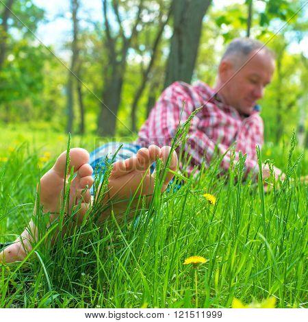 Bare Feet Closeup Among Green Grass